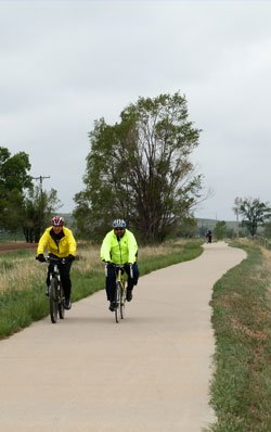 Two bike riders on the Poudre River Trail, Colorado